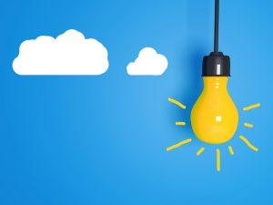 Yellow light bulb on blue background.